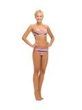 Beautiful woman in bikini. Bright picture of beautiful barefoot woman in bikini Royalty Free Stock Photo