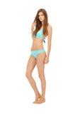 Beautiful woman in bikini. Bright picture of beautiful barefoot woman in bikini Royalty Free Stock Images