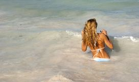 Beautiful woman in bikini going in the sea Stock Images