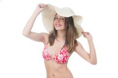 Beautiful woman in bikini and hat Stock Photos