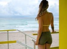 Beautiful woman in bikini at lifeguard station, Miami, USA. Beautiful woman in bikini at lifeguard station, Miami royalty free stock images