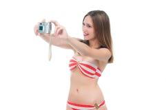 Beautiful woman in bikini making photo on the camera Stock Photo