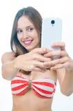 Beautiful woman in bikini making photo on the camera Stock Photos