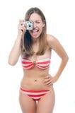 Beautiful woman in bikini making photo on the camera Royalty Free Stock Photography