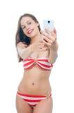 Beautiful woman in bikini making photo on the camera Royalty Free Stock Image