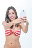 Beautiful woman in bikini making photo on the camera Royalty Free Stock Images