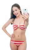 Beautiful woman in bikini making photo on the camera Stock Image
