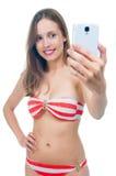 Beautiful woman in bikini making photo on the camera Royalty Free Stock Photo