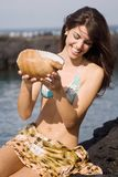 Beautiful woman with bikini with a marine conch Stock Photo