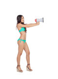 Beautiful woman in bikini with megaphone Stock Images