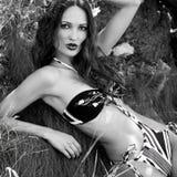 Beautiful woman in bikini outdoors Stock Photos