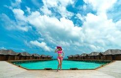 Beautiful woman in bikini on the Paradise island. Maldives Stock Images