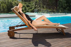 Beautiful woman in bikini relaxing by swimming pool Royalty Free Stock Photo