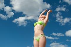 Beautiful woman in bikini resting on sky. Beautiful woman in bikini resting on blue sky Stock Photo