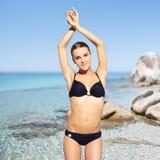 Beautiful woman in bikini on sea background Stock Image