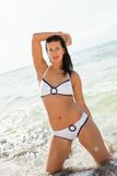 Beautiful woman in a bikini at the seaside Royalty Free Stock Photos