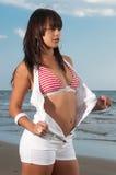 Beautiful woman with bikini and short at the beach Royalty Free Stock Photo