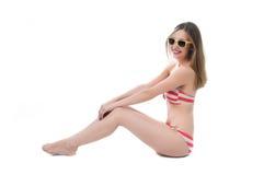 Beautiful woman in bikini sits Stock Photography