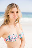 Beautiful woman in bikini standing on the beach Royalty Free Stock Photo