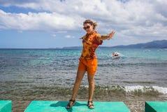 Beautiful woman in bikini sunbathing at the stock photos