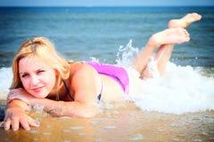 Beautiful woman in bikini sunbathing seaside Stock Image