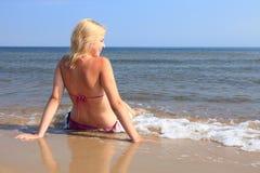 Beautiful woman in bikini sunbathing seaside Stock Photo