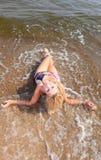 Beautiful woman in bikini sunbathing seaside Royalty Free Stock Photos