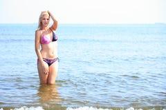 Beautiful woman in bikini sunbathing seaside Stock Photos