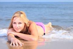 Beautiful woman in bikini sunbathing seaside Royalty Free Stock Photo