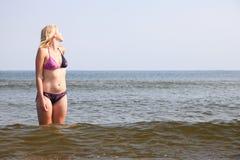 Beautiful woman in bikini sunbathing seaside Stock Photography