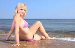 Beautiful woman in bikini sunbathing seaside Stock Images