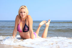 Beautiful woman in bikini sunbathing seaside Royalty Free Stock Photos