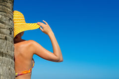 Beautiful woman in bikini and Sunhat standing with hands raised Royalty Free Stock Images
