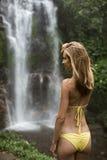 Beautiful woman in bikini and waterfall. stock photography