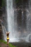 Beautiful woman in bikini and waterfall. stock photo