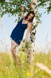 Beautiful woman at the birch. Summer meadow Royalty Free Stock Photo