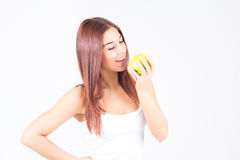 Beautiful woman bites apple. Healthy lifestyle. Stock Image