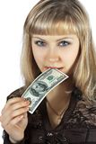 Beautiful woman bites hundred dollar banknote Stock Photos