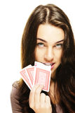 Beautiful woman bites in a poker card Stock Images
