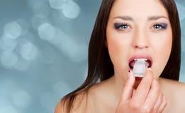 Beautiful woman biting an ice cube Stock Photos