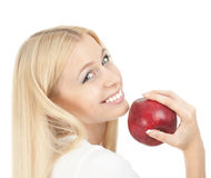 Beautiful woman biting a red apple Stock Photography