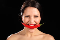 Beautiful woman biting on red chili pepper Stock Photos