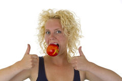 Beautiful woman biting into a red juicy apple Royalty Free Stock Photo