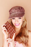 Beautiful Woman Biting In To Chocolate Royalty Free Stock Images