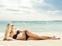 Beautiful woman in black bikini. Young and sporty girl posing on Stock Photography