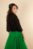Beautiful woman with black blouse and green skirt Royalty Free Stock Images