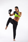 Beautiful woman with the black boxing gloves Royalty Free Stock Image