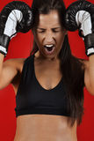 Beautiful woman with the black boxing gloves Stock Photography