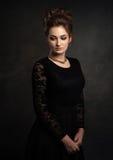 Beautiful woman on black classical dress. Vogue style photo. Stock Photos