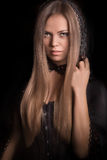 Beautiful woman with black cloak Stock Photo